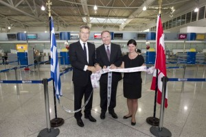 Yiannis Paraschis Athens International Airport's (AIA) CEO; Robert Peck, Ambassador to Canada in Greece; and Isabelle Knoblauch, Air Canada's general manager Switzerland, Austria, Italy and Greece at AIA welcoming the first flight of Air Canada rouge from Toronto to Athens.