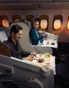 Passengers enjoying Emirates meals on-board.