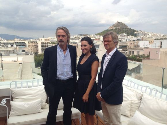 Oscar-winning actor Jeremy Irons, Greek Tourism Minister Olga Kefalogianni and Danish Academy Award-winning film director Bille August on a hotel rooftop in Athens.