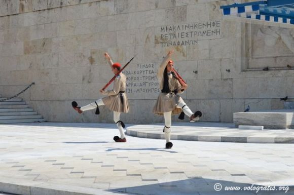 Evzone guards demonstrate their distinctive march outside the Greek Parliament building.