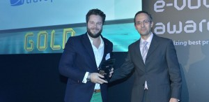 "Philip Brinkman, CEO of Travelplanet24 (left), accepts the ""Internationalized E-business"" e-volution award."