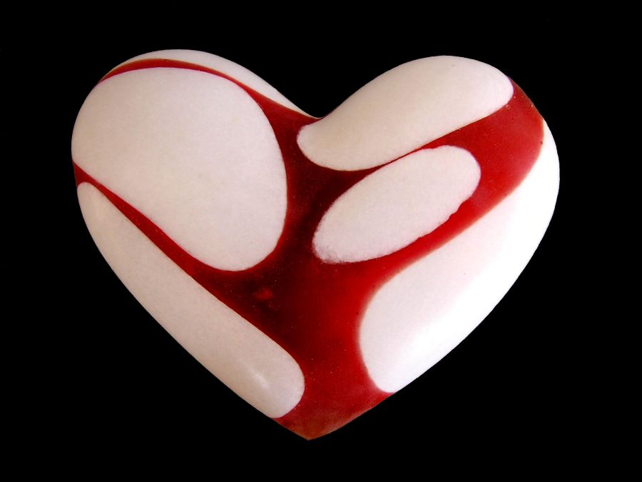 Benos-Palmer's marble hearts are asymmetrically restored, often scared red with memories.