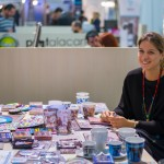 """""""Idisti, Greece with a twist"""" stand - Alexandra Charitatou, co-founder. Idisti is a new enterprise that sells Greek items exclusively.  From souvenirs to giftware to housewares... Idisti has it all."""