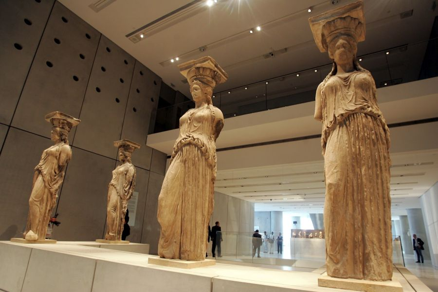 The renowned Caryatids in the Acropolis Museum. The figures were originally six but one was removed by Lord Elgin in the early 19th century and is now in the British Museum in London. The pedestal for the Caryatid removed to London (second from the left on the front) remains empty.