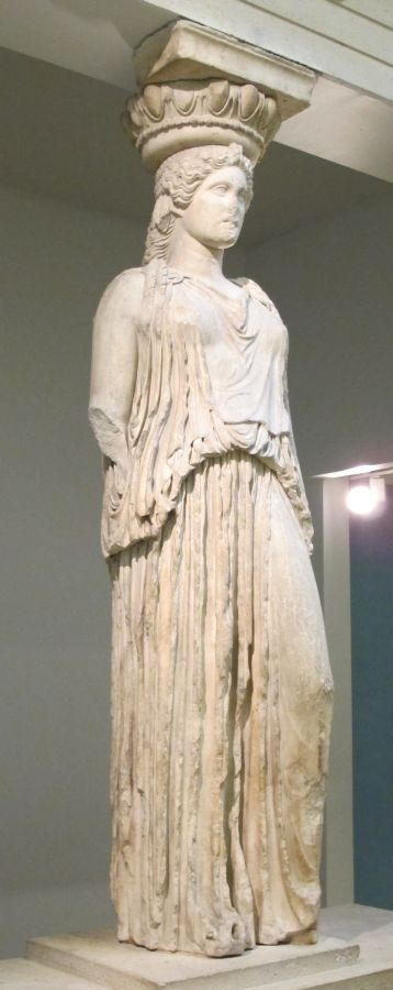 A caryatid from the Erechtheion, stands alone, displayed at the British Museum.