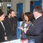 ITB 2014 - Greek Tourism Minister Olga Kefalogianni and Hans-Joachim Fuchtel, Parliamentary State Secretary and Member of Bundestag in discussion with Archimandrite Spyridon Katramados, secretary of the Synodal Office of Religious Tourism of the Church of Greece.