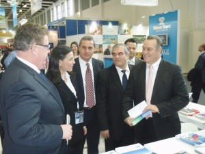 ITB 2014 - Region of Central Macedonia stand: German Federal Deputy Labor Minister Hans-Joachim Fuchtel and Greek Tourism Minister Olga Kefalogianni in discussion with Central Macedonia's vice governor of tourism development, Yiannis Giorgos.