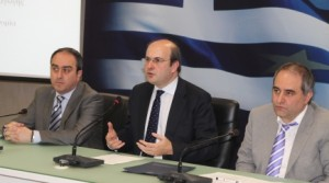 Greek Minister for Development & Competitiveness Kostis Hatzidakis (center).