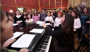 Children of the GNO Chorus alongside Chorus Mistress Mata Katsouli. Photo: nationalopera.gr