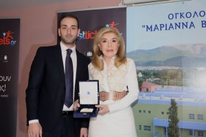 "Nikolaos Koklonis, president of AirFastTickets, and Marianna V. Vardinoyanni, president of the ""ELPIDA"" Association of Friends of Children with Cancer. Photo source: webershandwick"