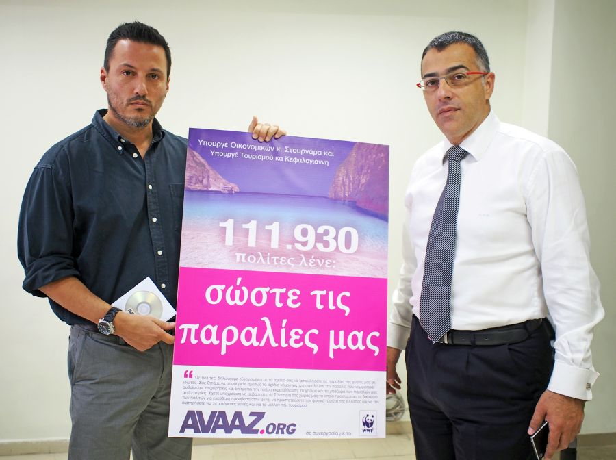 "The head of WWF Greece, Demetres Karavellas, hands over the petition launched by AVAAZ.ORG to the general secretary for public property of the Greek Finance Ministry, Avraam Gounaris. The poster accompanying the petition reads: ""111,930 citizens say: Save our beaches."" Photo © WWF Greece"