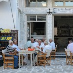 Old men playing cards and backgammon (Tavli) at a local cafe.