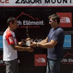 The winner of the 80km race, Dimitris Theodorakakos, receiving his prize from the brand manager of The North Face, Manolis Mavroidis.