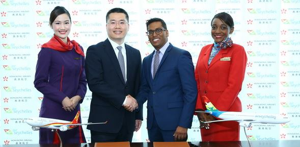 Mr. Li Dianchun, Commercial Director of Hong Kong Airlines, and Mr. Manoj Papa, Chief Executive Officer of Air Seychelles, sign a codeshare agreement between the two airlines.