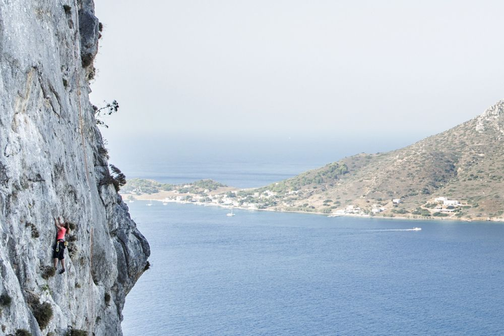 A climber taking part in the Climbing Marathon of the The North Face Kalymnos Climbing Festival 2014. The island of Telendos is clearly visible in the background. Photo © Eddie Gianelloni, The North Face
