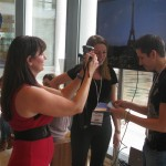 Coach Deb filming the winner of the Eurorail competition for travel bloggers at TBEX Athens.