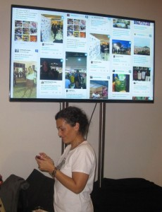 A travel blogger tweets about Athens during the TBEX opening party at Technopolis. All tweets were displayed on screen in real-time.