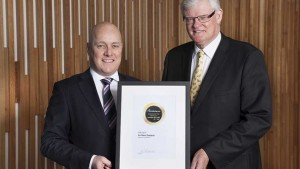 Air New Zealand's Christofer Luxon accepting the award from  chief judge Geoffrey Thomas. Photo source: Discover the World