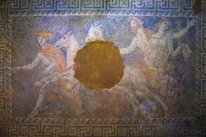 A mosaic of the god Pluto abducting Persephone covers the tomb's second chamber's floor.