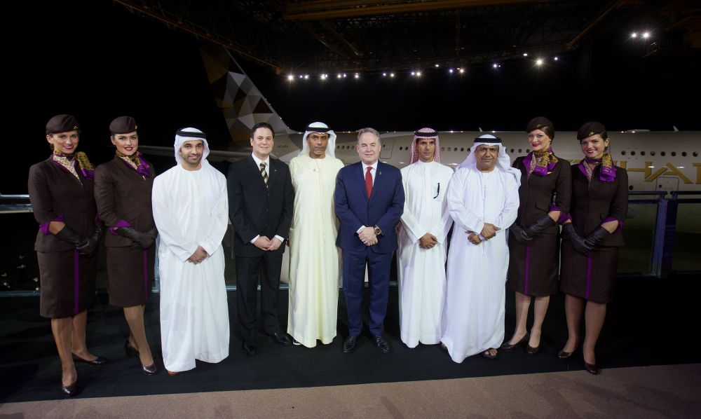 (Left to right all Etihad Airways) Hareb Al Muhairy, VP UAE; Peter Baumgartner, Chief Commercial Officer; Abdul Qader Hussein Ahmed, VP Government and International Affairs; James Hogan, President and Chief Executive Officer; Khaled Al Mehairbi, SVP Government and Aeropolitical Affairs; Hasan Al Hammadi, SVP Executive Affairs; with members of the airline's cabin crew, in front of Etihad Airways' first A380.