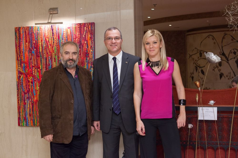 The general manager of Sofitel Athens Airport, Cyril Manguso, with sculture Vangelis Polyzos and artist Mily Martionou.