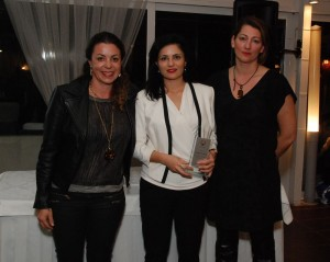 Despina Mavridou, public relations for Goldair Tourism (center), was awarded by Olympic silver medalists for water polo Georgia Ellinaki and Eftihia Karagianni of the Hellenic Olympic Winners Association.