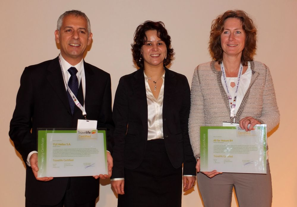 The tourism program officer of the United Nations Environment Program, Helena Rey (center), awarded two companies with the Travelife Certificate for Tour operators & Travel agents at the Dutch tourism trade fair Vakantiebeurs: Greek DMC TUI Hellas and Dutch tour operator All for Nature Travel. The awards were received by Spyros Kritikos (TUI Hellas Heraklion) and Annemiek van Gijn (All for Nature Travel).