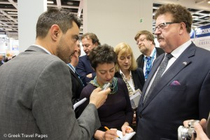 GTP's Nikos Krinis speaking to Parliamentary State Secretary to the Federal Minister for Economic Cooperation and Development Hans-Joachim Fuchtel (R).