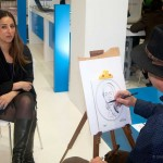 Caricaturist drawing a Greek tourism professional.