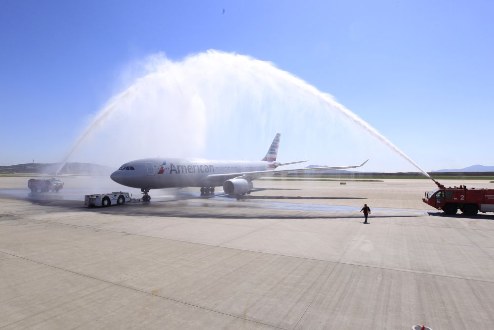 The traditional water arch welcomed the first airplane of American Airlines to Athens International Airport.
