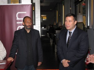 HotelBrain's Panos Paleologos looks on as SouthBridge Europe financial advisor George Mavridis speaks to the media.
