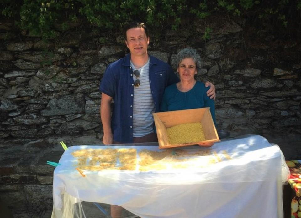 "Jamie Oliver with Ikaria local Mrs Maria making ""trahana"". Photo source: Jamie Oliver (@jamieoliver)"