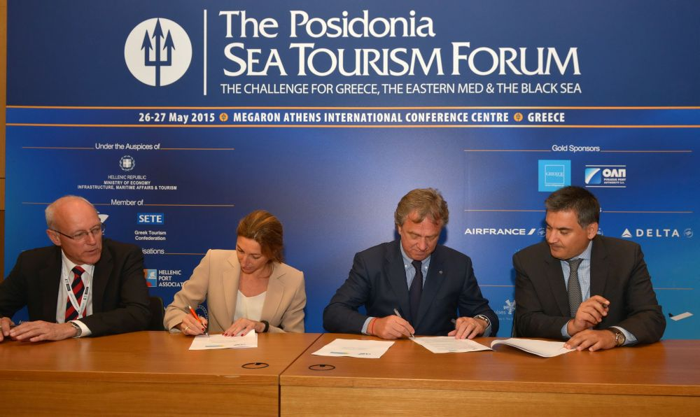 Raphael von Heereman, Secretary General of CLIA Europe; Carla Salvadό, president of MedCruise and Marketing and Cruise Manager of the Port of Barcelona; Pierfrancesco Vago, President of CLIA Europe and Executive Chairman of MSC Cruises; and Thanos Pallis, General Secretary of MedCruise, sign the cooperation agreement.