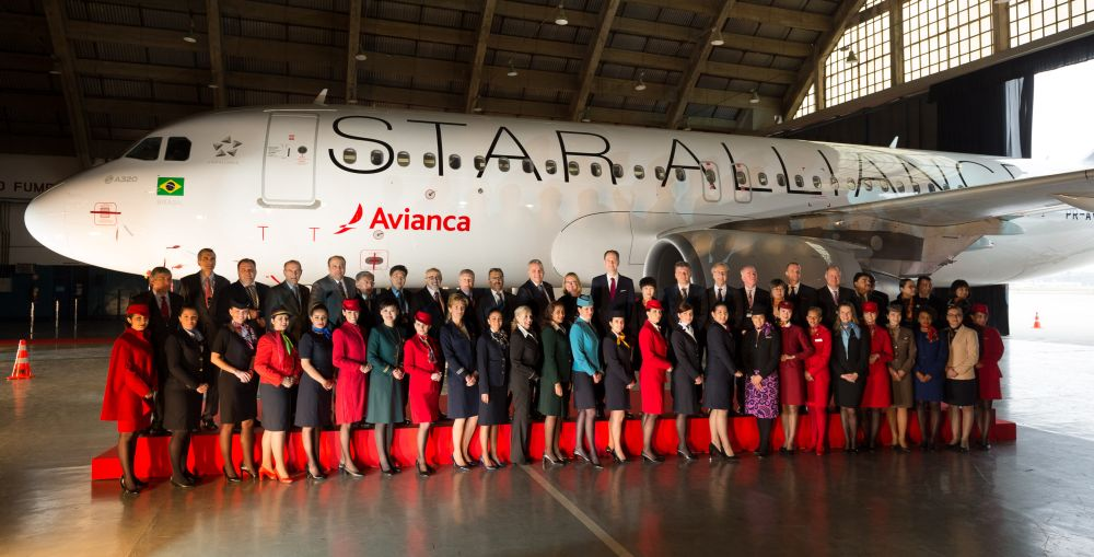 Star Alliance CEOs and top executives, along with uniformed staff members welcome Avianca Brasil to the Star Alliance family.