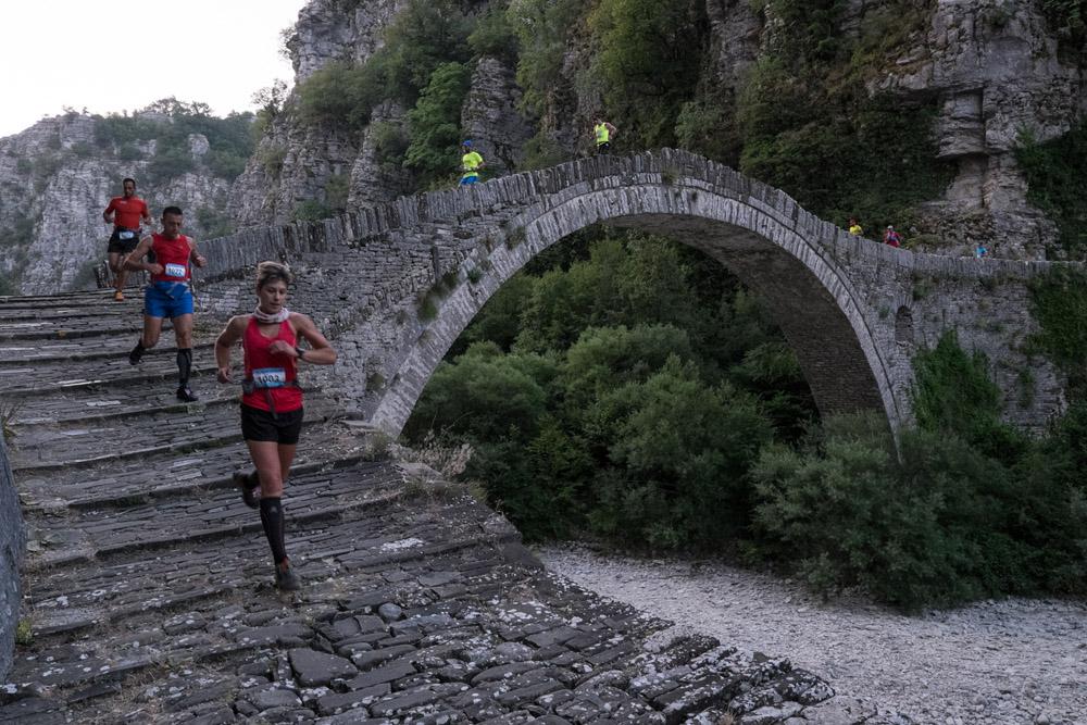 Athletes crossing the traditional Kokkori bridge.