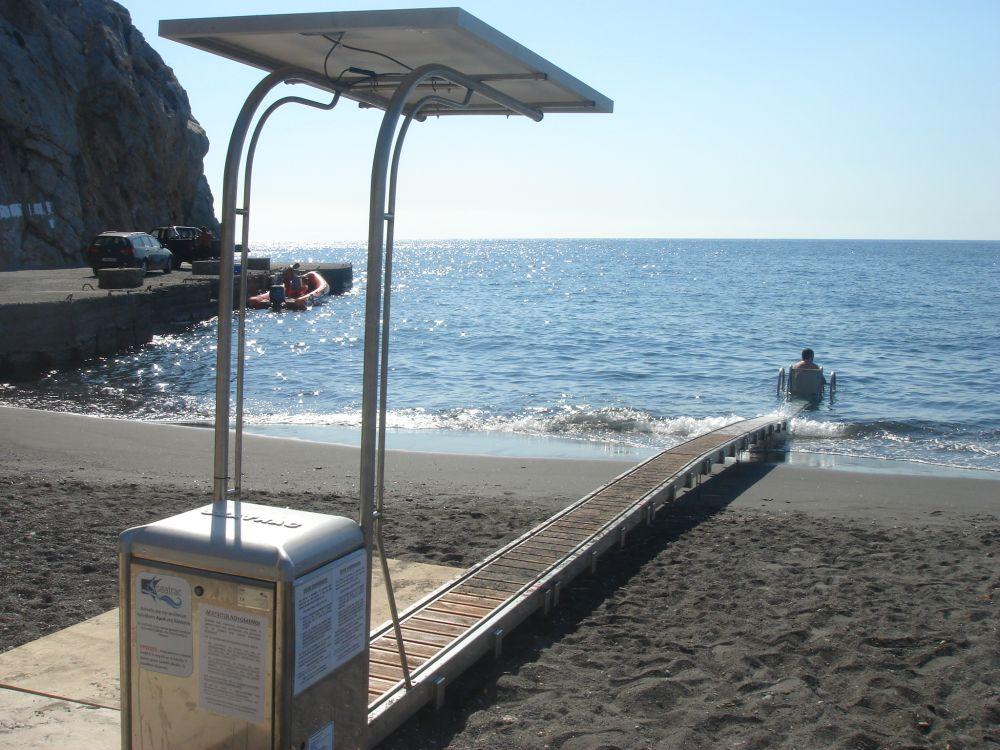 Perissa Beach On Santorini Offers Swimming Access To The