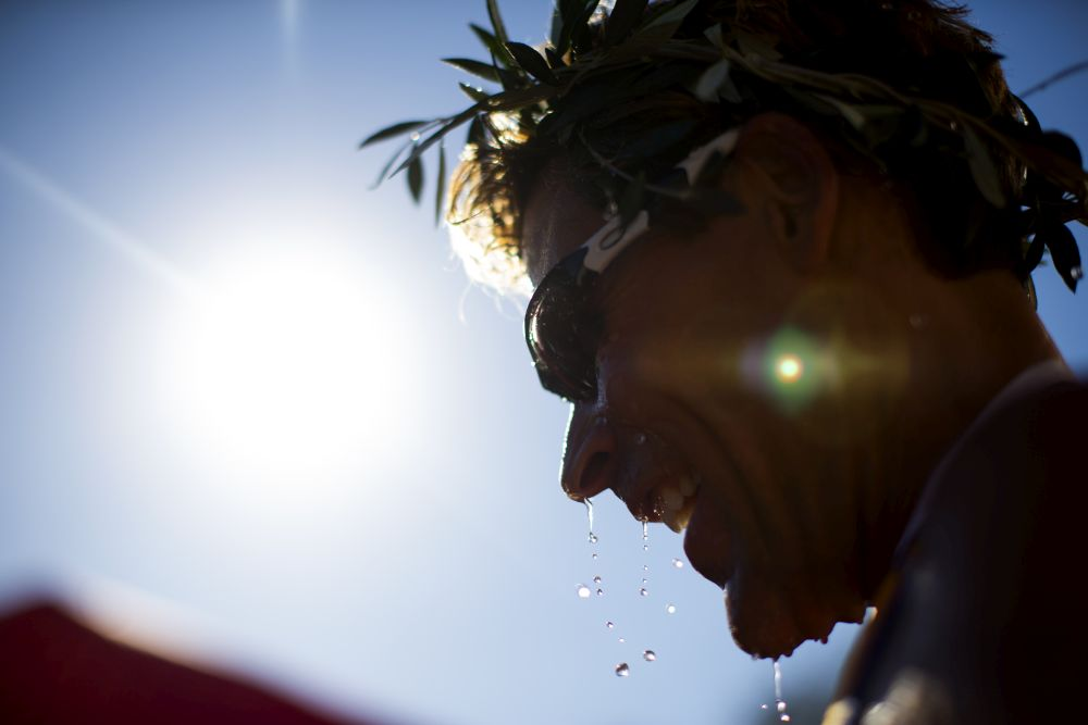 Ultramarathon runner Dean Karnazes of the U.S.A. wears an olive wreath after finishing his run during the Navarino Challenge Run at  on October 20, 2013 in Pylos, Greece.  (Photo by Vladimir Rys)