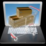 E-commerce. Shopping cart on laptop. Online shopping Concept