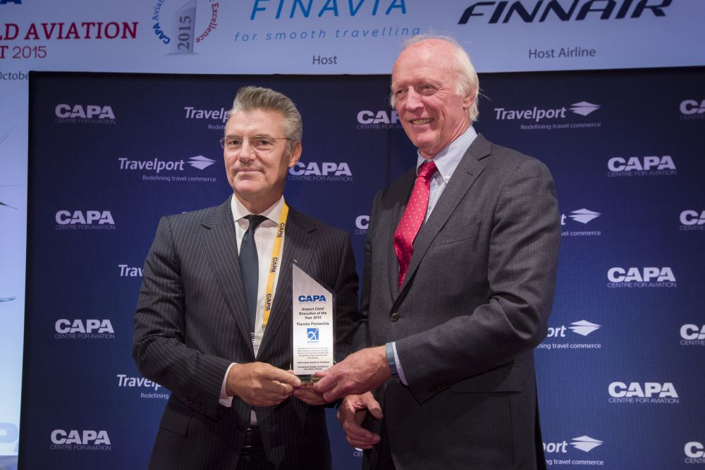 Athens International Airport CEO Yiannis Paraschis receives award by CAPA's Executive Chairman Peter Harbison.
