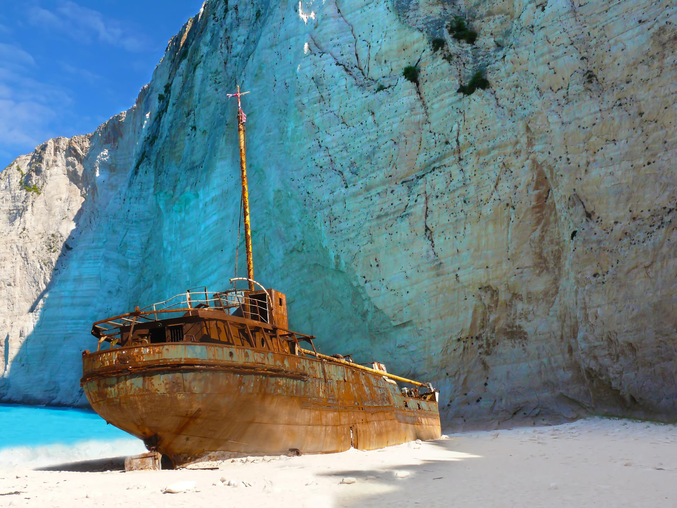 Island With Abandoned Ship On Beach