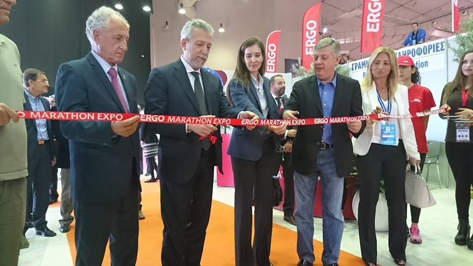 Deputy Sports Minister Stavros Kontonis cutting the ribbon for the opening of the ERGO Marathon Expo 2015 with the president of the Association of International Marathon and Distance Races' (AIMS), Paco Borao and SEGAS President Kostas Panagopoulos. Photo credit: Vassilis Koutroumanos
