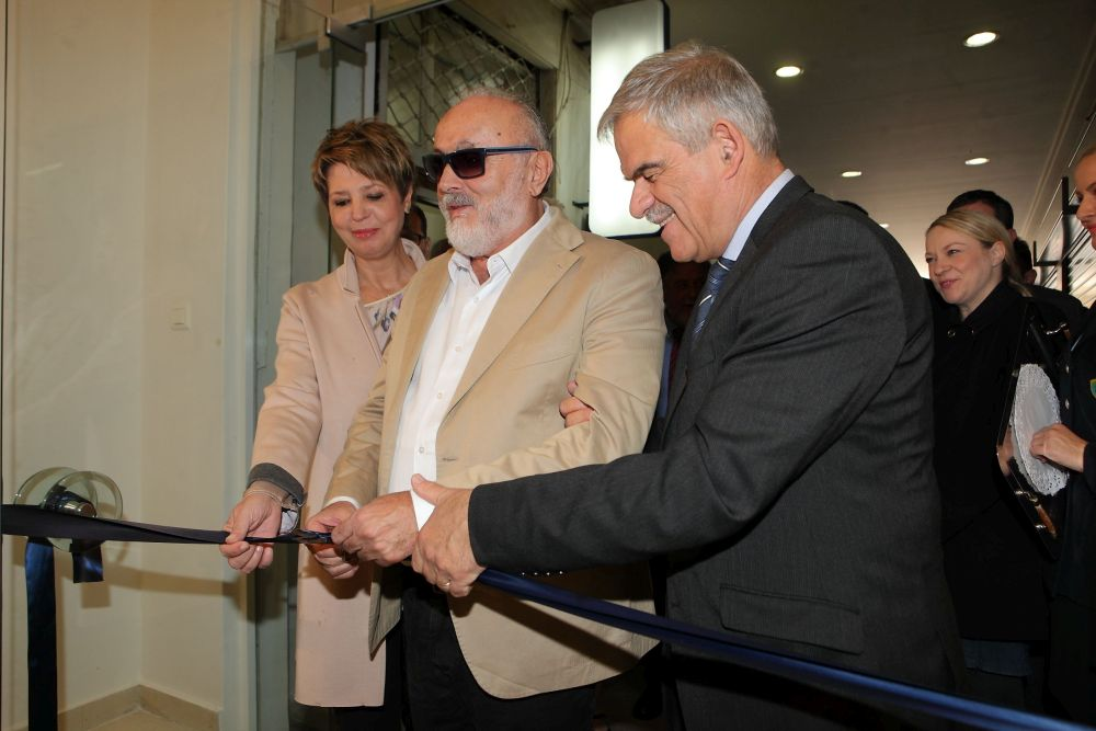 Greek Interior Minister Panagiotis Kouroublis cutting the ribbon for the opening of the Tourist Police Visitors Help Office in Athens. He is with Government spokeswoman Olga Gerovasili and Alternate Minister for Citizens' Protection Nikos Toskas.
