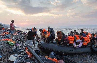 Refugees arrive on the Greek island of Lesvos after crossing the Aegean Sea from Turkey.