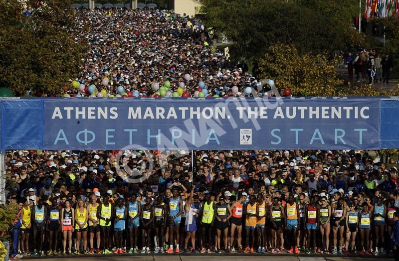 Athletes line up at the start of the 32st Athens Classic Marathon race in Marathon village, 42km east of Athens, Greece, 09 November 2014. More than 13.000 athletes from 120 countries participate in the 32st Athens Classic Marathon marking the 2,504 years anniversary of the Marathon Battle. EPA/ORESTIS PANAGIOTOU