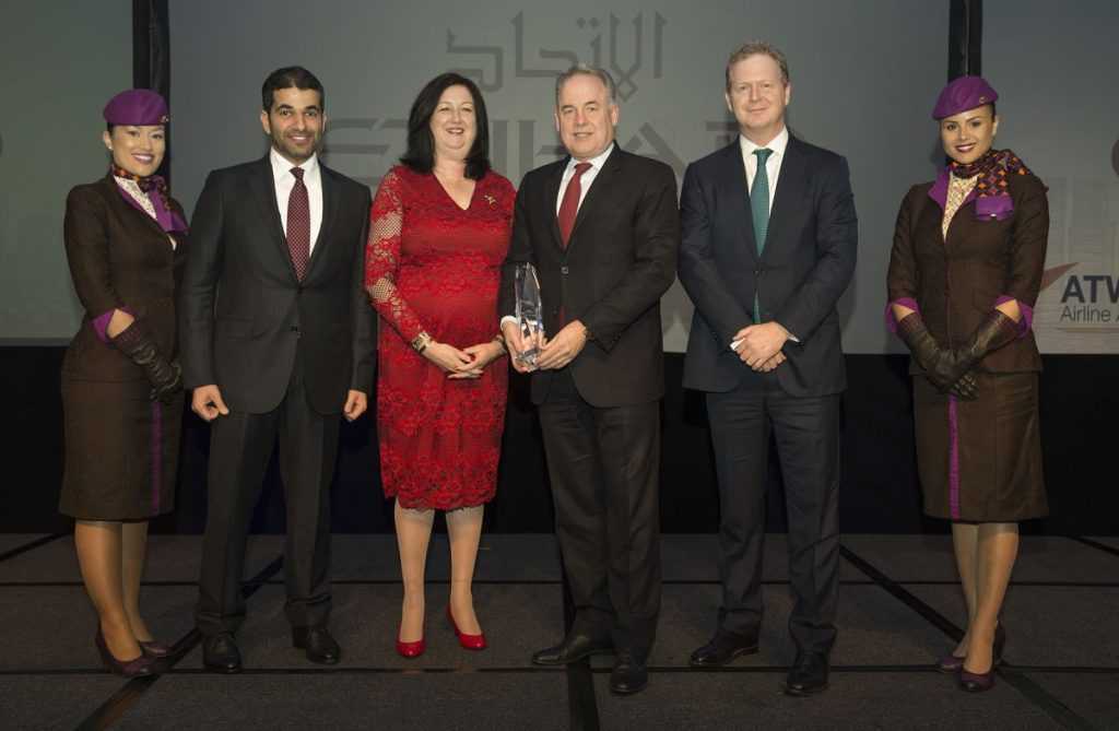 Flanked by Etihad Airways' cabin crew are, from left: Hareb Al Muhairy, Senior Vice President Corporate and International Affairs; Karen Walker, ATW Editor-in-Chief; James Hogan, President and Chief Executive Officer; and James Rigney, Chief Financial Officer.
