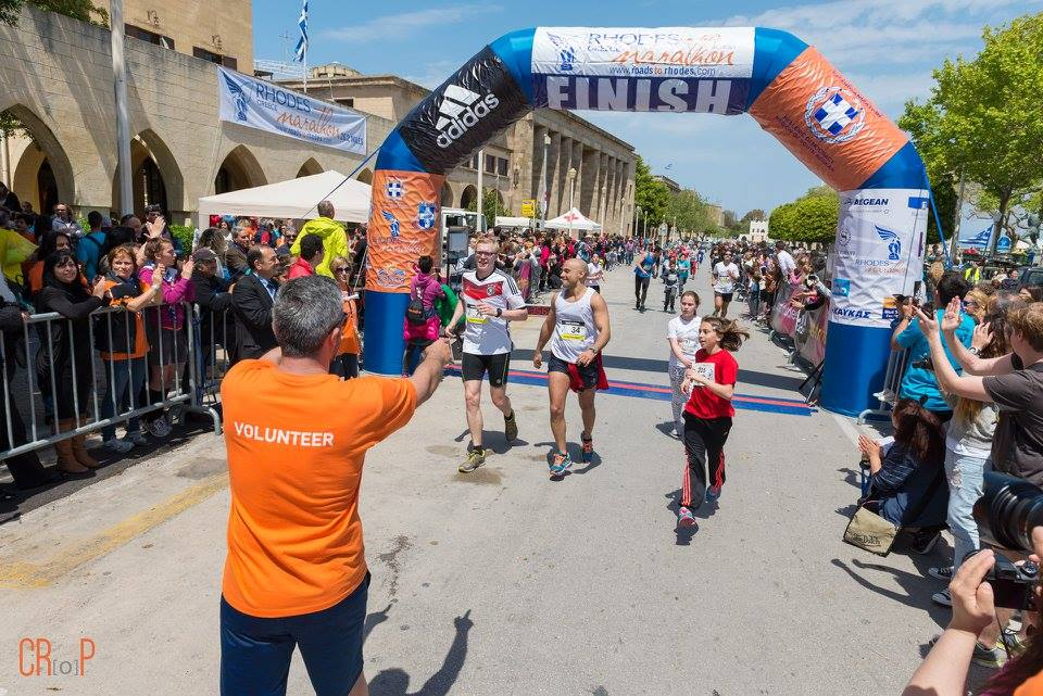 Runners at the finish line. Photo credit: C.Ro.P Creative Rodos Photographers