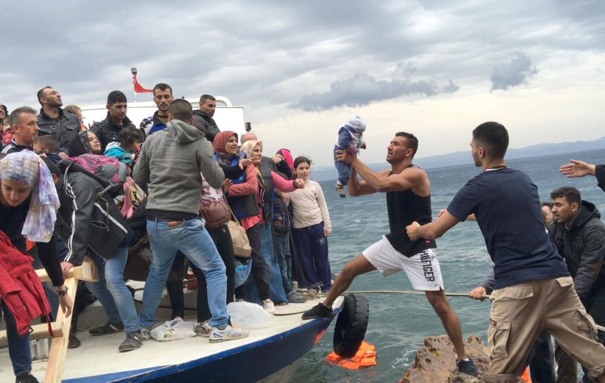 Asylum seekers and migrants descend from a large fishing vessel used to transport them from Turkey to the Greek island of Lesbos. Photo © 2015 Zalmaï for Human Rights Watch