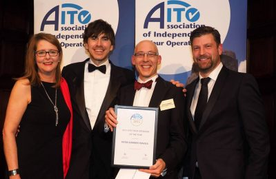 Travel writer and TV presenter Simon Reeve (second from left) after giving the 2015 AITO Tour Operator of the Year Gold Award to Peter Sommer (second from right) of Peter Sommer Travels.