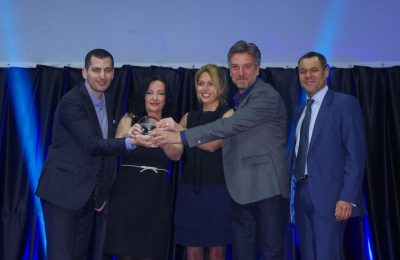 Athens Airport's communications and marketing director, Ioanna Papadopoulou (second from left), holding the Routes Europe 2016 award.