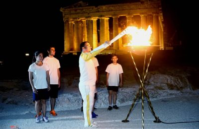 Three times Οlympic winner Pyrros Dimas lights the cauldron with the Olympic Flame in Acropolis of Athens.